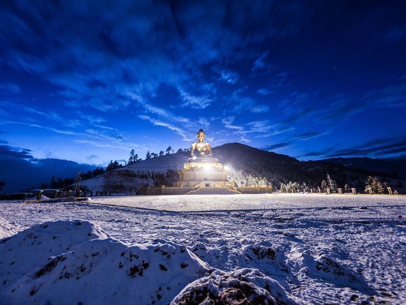 The buddha statue in Thimphu after a night of snow